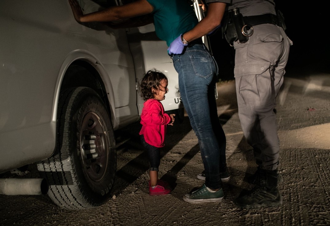 Crying girl on the border', – John Moore, United States, Getty Images